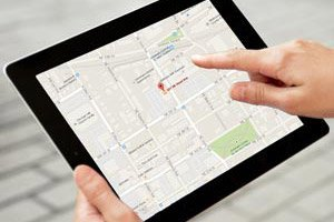 Person holding an Ipad with google maps displaying directions to Active Family Chiropractic.